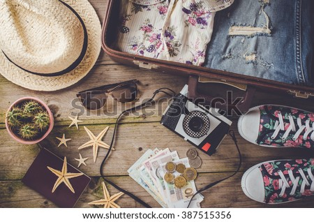 Travel preparations on wooden table - stock photo