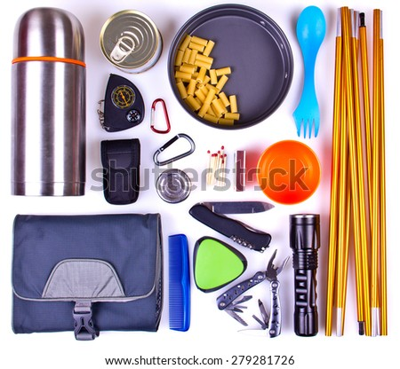Travel set. Tourist outfit for camping or hiking. Various professional tools and items for outdoors pastime on white background. - stock photo