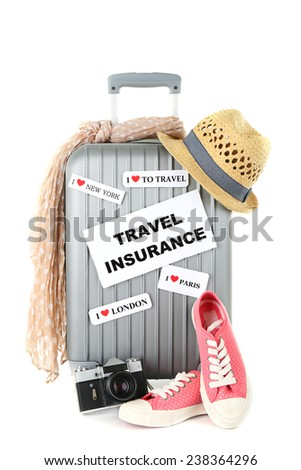 Travel suitcase and tourist stuff with inscription  travel insurance isolated on white - stock photo