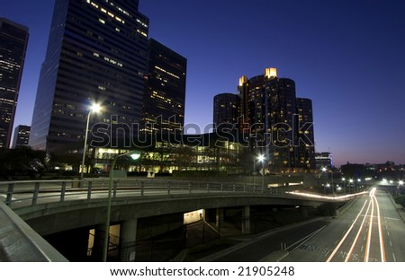 Travel through Los Angeles at night with traffic as trails of light - stock photo