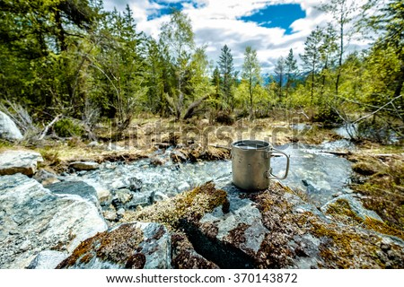 Travel titanium cup. Lunch during the journey to the wild. Camping lifestyle. - stock photo