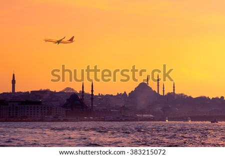 Travel to Istanbul on passenger transport in Turkey. Sunrise in golden colors with soft light effect. Turkish landmarks - panoramic cityscape of Istanbul with silhouette of mosques on seaside. - stock photo