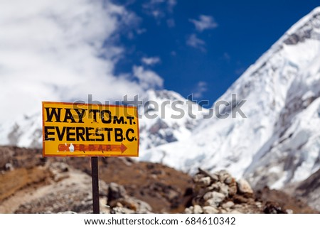 Travel to Mount Everest Base Camp signpost in Himalayas, Nepal. Khumbu glacier and valley snow on mountain peaks, beautiful view landscape