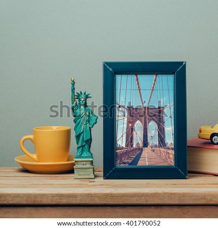 Travel to New York, USA concept with poster mock up template and souvenirs on wooden table - stock photo
