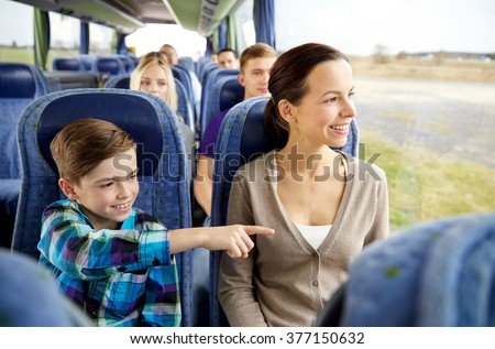 travel, tourism, family, technology and people concept - happy mother and son riding in travel bus - stock photo