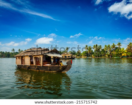 Travel tourism Kerala background - houseboat on Kerala backwaters. Kerala, India - stock photo
