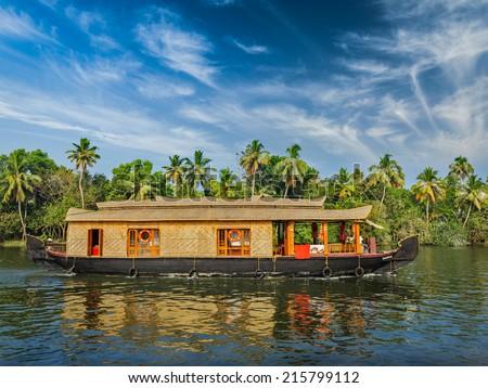 Travel tourism Kerala background - houseboat on Kerala backwaters. Kerala, India - stock photo