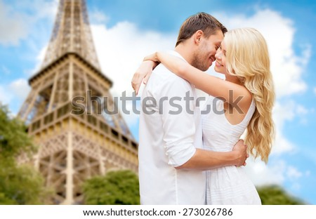 travel, tourism, people, love and dating concept - happy couple hugging over eiffel tower in paris background - stock photo
