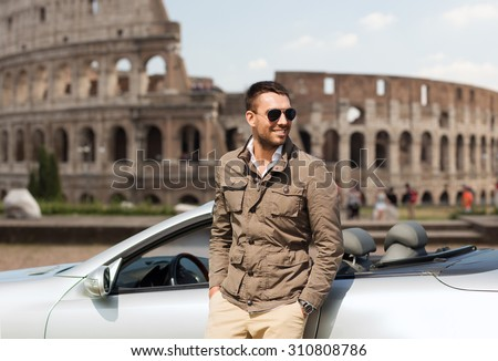 travel, tourism, road trip, transport and people concept - happy man near cabriolet car over coliseum in rome background - stock photo