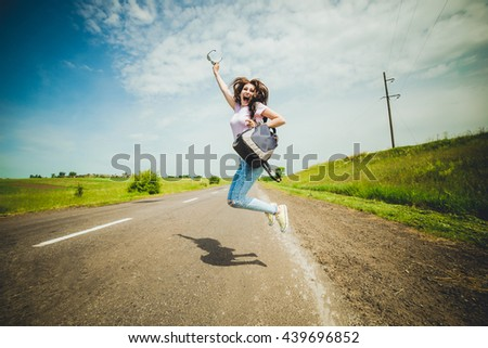 travel tourist . Travel woman hitchhiking and jump