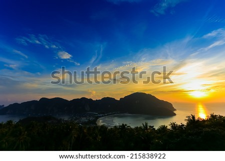 Travel vacation background with sunset at Phi-Phi island, Krabi Province, Thailand - stock photo