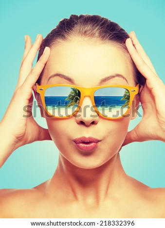 travel, vacation, summer holidays and happy people concept - portrait of amazed teenage girl in sunglasses with beach reflection - stock photo