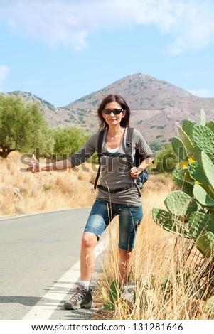 Travel woman hitchhiking. Greece. Crete. - stock photo