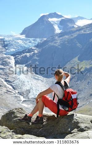 Traveler at theTrift glacier. Switzerland - stock photo