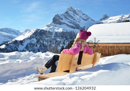 Traveler enjoying Alpine panorama. Switzerland - stock photo