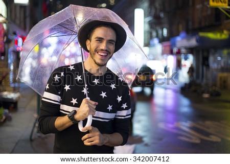 Traveler exploring the city on a rainy night. Chinatown, New York - stock photo