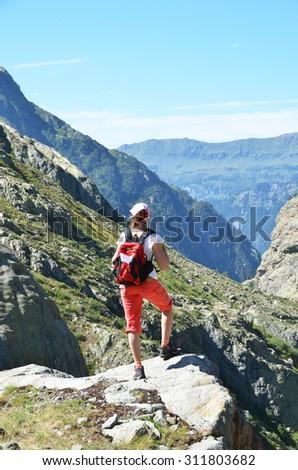 Traveler in the Swiss Alps - stock photo