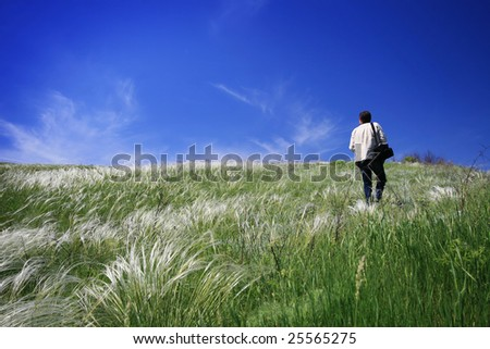 traveler on summer green field