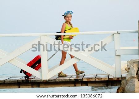 Traveler, summer, beach - lovely girl ready for summer vacation - stock photo