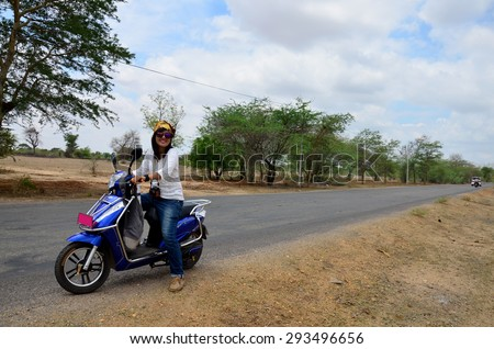 Traveler thai woman ride motorcycle travel around Ancient City in Bagan (Pagan) Archaeological Zone, Myanmar with over 2000 Pagodas and Temples. - stock photo