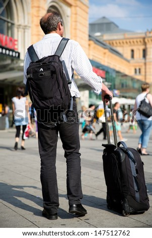 traveler with his bags on public place in Hannover, Germany - stock photo