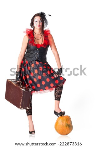 Traveler with suitcase and pumpkin - stock photo