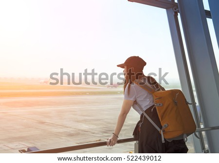 Traveler woman at the airport window, soft and select focus