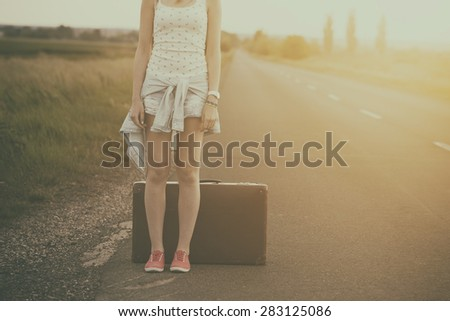 Traveler woman on the road - stock photo