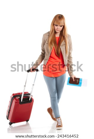 Traveler woman with a bag - isolated over a white background  - stock photo