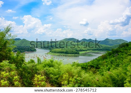 Travelers enjoy the beauty of nature on their summer vacation on bamboo raft, spending leisure time during their lunch at Huay Krating Reservoir, Loei Province, Thailand. - stock photo