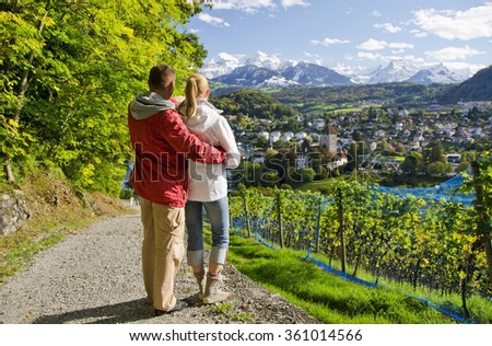 Travelers on the top of a hill. Spiez, Switzerland - stock photo