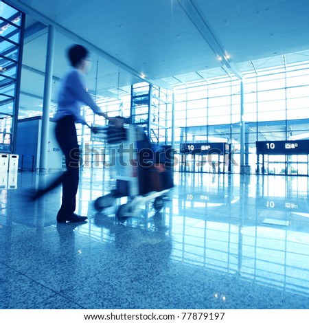 travelers silhouettes at airport - stock photo