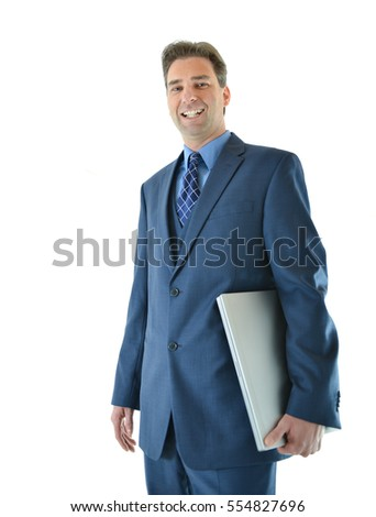 Traveling business man standing with laptop