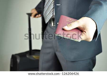 Traveling businessman handing passport - airport security concept - stock photo