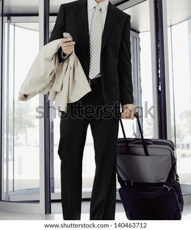 traveling businessman talking on phone - stock photo