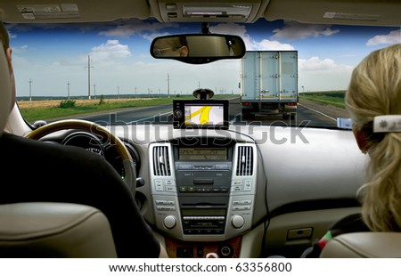 Traveling by car with a navigator - stock photo