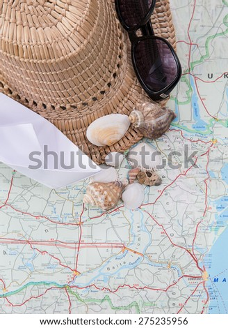 traveling concept, hat, sunglasses, booth - stock photo