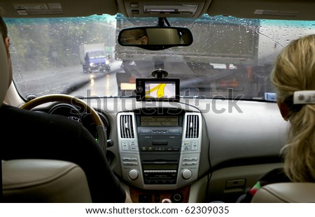 Traveling in the rain with the navigator - stock photo