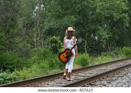 Traveling musician themed photoshoot. - stock photo