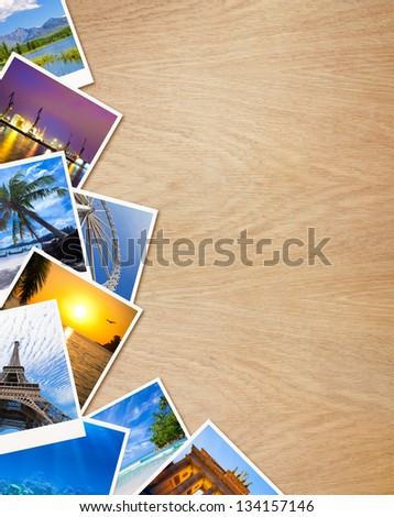 Traveling photos on wooden background - stock photo