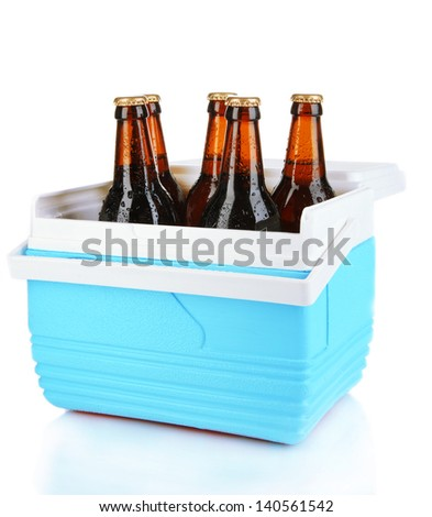 Traveling refrigerator with beer bottles isolated on white - stock photo