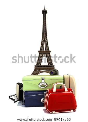 Traveling the world, suitcases with a digital camera ,and the Paris Eiffel tower in the background. - stock photo
