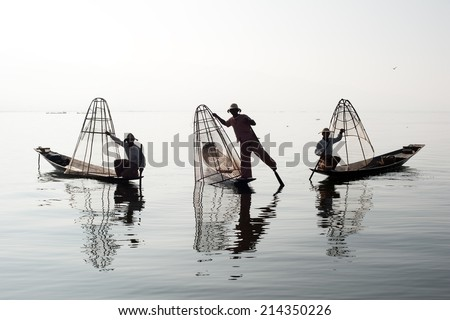 Traveling to Myanmar, outdoor photography of fisherman on traditional boat. Intha people from Shan state of Burma  - stock photo