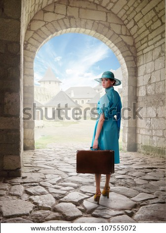 traveling woman in retro clothing.Collage with old castle as a background - stock photo