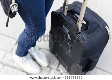 Traveling woman waiting for transport