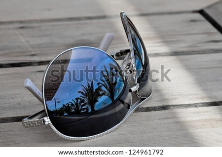 Traveller dreams concept - reflection on sunglasses - stock photo