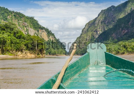 Travelling by wooden boat on Beni river in Bolivian jungle (Rurrenabaque region) - stock photo