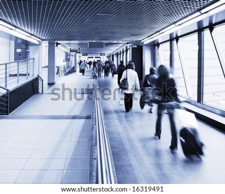 travelling people in a station