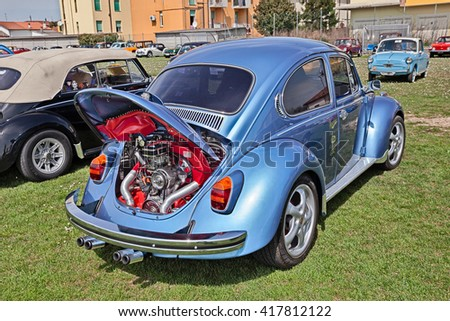 "TRAVERSARA, RA, ITALY - APRIL 11: vintage Volkswagen Type 1 (Beetle) with tuned chromed engine in classic car rally ""Raduno auto e moto d'epoca"" on April 11, 2015 in Traversara, RA, Italy"