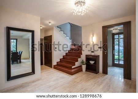 Travertine house: entrance and hallway, modern interior - stock photo